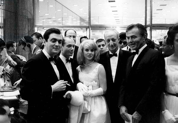 Director Stanley Kubrick, producer James Harris, comedian Sue Luon and actor James Mason at the premiere of the film Lolita, 1962