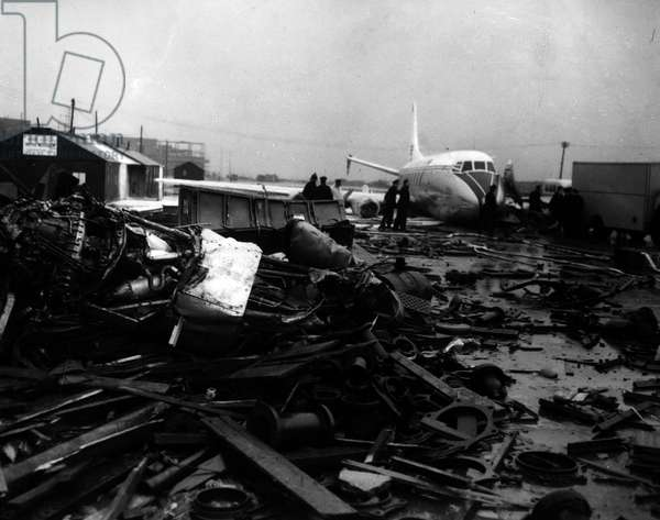 Jan. 01, 1955 - Two Injured As B.E.A. Viscount Airliner Crashes On Take-Off At London Airport. The pilot and one passenger were injured when a B.E.A. Viscount airliner crashed on the take-off at London Airport. The aircraft had taken a wrong turning on to a disused runway in mistake for the main take-off runway during the fog. It crashed into a barrier and ended up between a hangar and some builder's huts. One engine was thrown on to a stack of scrap metal. There were 25 passengers aboard the aircraft including two children. Keystone Photo Shows: - The tangled mass of steel - which is all that remained of one of the Viscount engines after the crash at London Airport