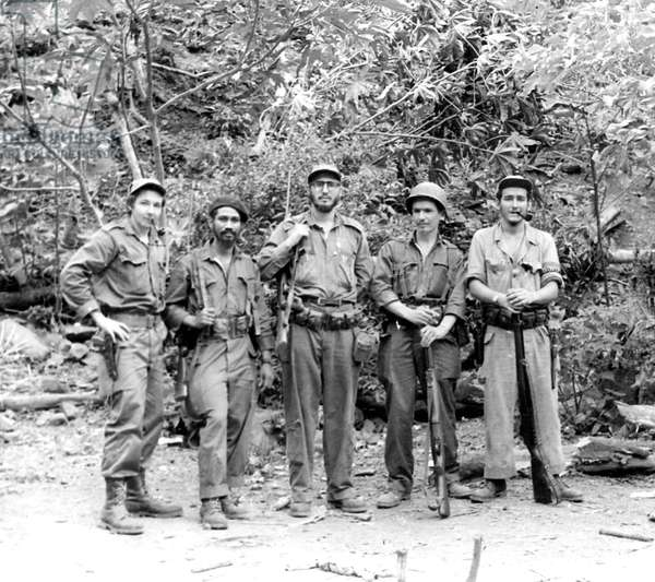 Portrait of Fidel Castro in the center, of his brother Raul (Raoul) on the left with rebel leaders in the mountains of Sierra Maestia in 1958 Cuba
