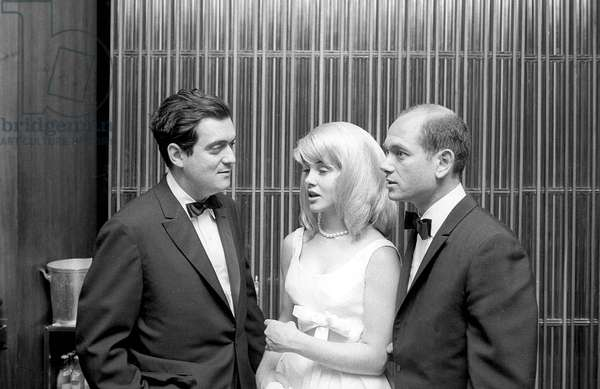Director Stanley Kubrick with comedian Sue Lyon and producer James Harris at the premiere of the film Lolita, 1962 (b/w photo)