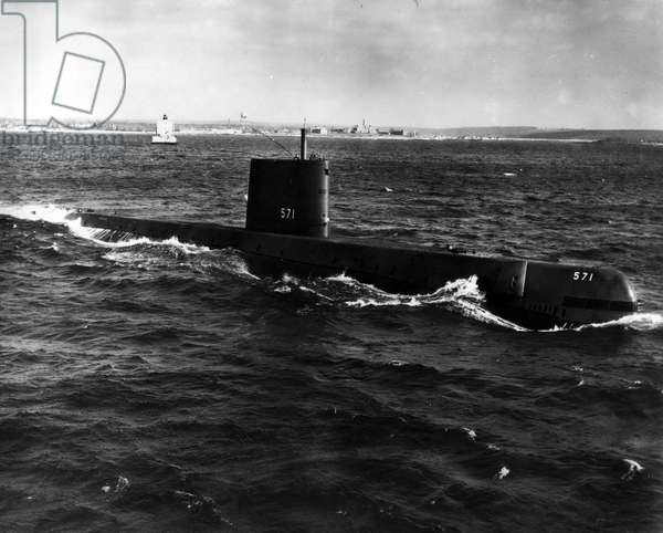 Jan. 01, 1955 - Unshering in a New Era of transportation, the atomic powered submarne USS Nautilus, is pictured underway on her initial sea trial in Long Island Sound on January 17, 1955. The historic moment came at 11:01 a.m. when the Nautilus under nuclear power cast off and got underway from the Croton, Conn, dock of her builder, the Electric Boat Division of General Dynamics Corporation. Public Health Department, Electric Boat Division, General Dynamics Corporation