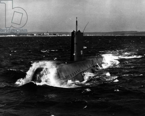 Jan. 01, 1955 - Ushering in a New Era of transportation, the atomic powered submarine USS Naitilus, is pictured underway on her initial sea trial in Long Island Sound on January 17, 1955. The historic moment came at 11:01 a.m. when the Nautilus under nuclear power cast off and got underway from the Groton, Conn, dock of her builder, the Electric Boat division of General Dynamic Corporation. Public Health Relations Department, Electric Boat Division, General Dynamics Corporation