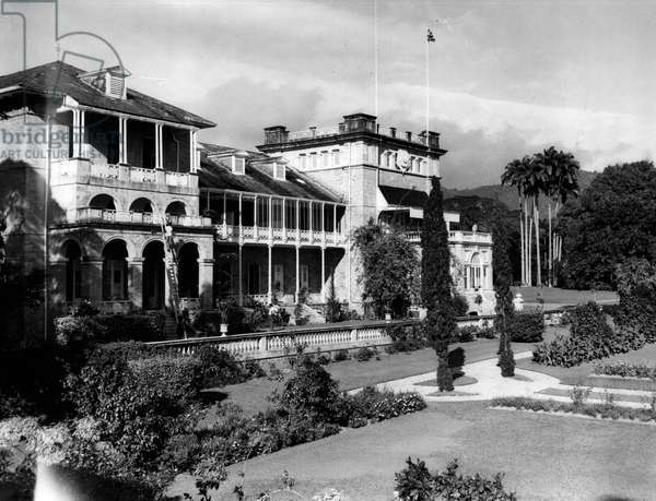 Jan. 01, 1955 - Preparations In Trinidad For The Arrival of Princess Margaret.. Keystone Photo Shows: - View of Government House, Trinidad where Princess Margaret will stay as guest of H.E. The Governor - Major Gen Sir Hubert Rance and Lady Rance. On right, of picture below flag poles will be Princess Margaret's suite. Her balcony over looks a wonderful garden of exotic plants and trees