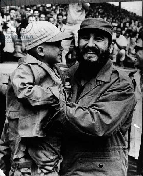 Feb. 16, 1965 - Havana, Cuba - FIDEL ALEJANDRO CASTRO RUIZ (born August 13, 1926), with a very young baseball enthusiast at the American Stadium havana