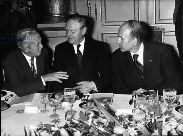 Dec. 10, 1974 - British Prime Minister Harold Wilson, Taoiseach of Ireland Liam Cosgrave, and French President Valery Giscard d'Estaing talking over dinner at the Elysee Palace