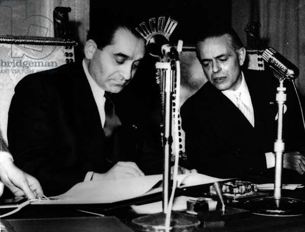 Jan. 01, 1955 - French Italian Treaty Signed... Mendes-France in Rome: Photo Shows M. Mendes France the Prime Minister of France and M. Gaetand Martino seen as they signed the French-Italian Treaty - dealing with Immigration and a Joint Policy in Africa - at the Villa Madame, Rome, recently
