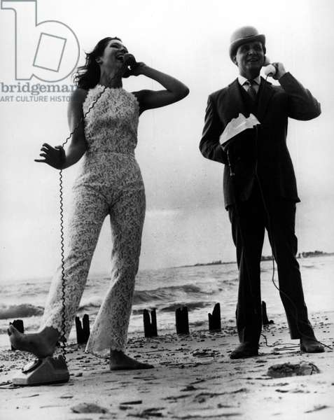 Sep. 09, 1965 - Diana Rigg wearing a catsuit designed by John Bates of jean Varon for her Avengers wardrobe and Patrick Macnee wearing a self-designed suit, made by Bailer & Weatherill