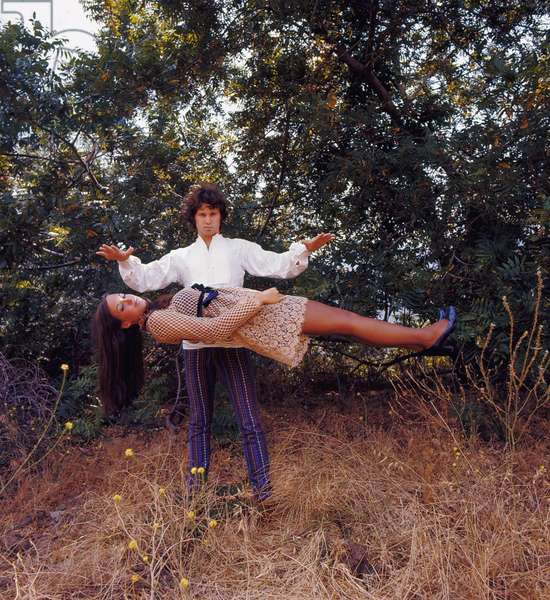 Portrait of Jim Morrison and Cathy Christiansen (simulating the levitation) 1968 Photo Bez