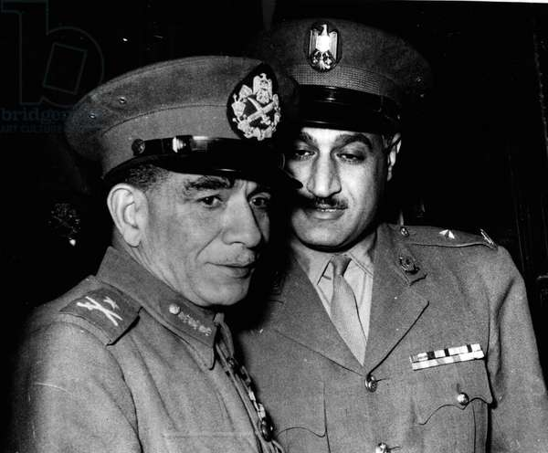 Tue 03, 1954 - President Neguib taken to hospital condition said to be serious.: President Neguib collapsed at Cairo Airport this morning after seeing off King Saudi of Saudi Arabia he was rushed to hospital after an injection of atropine his condition was said to be slightly improved. President Neguin had earlier attended a meeting of the Revolucion Council with others including his Second-in-Command-Colonel Nasser, with King Saud as the host at Midnight in the Tahira Palace. The King acted as mediator between the President and members of the Council. The President wants the Council dissolved but others of the Council think it should continue