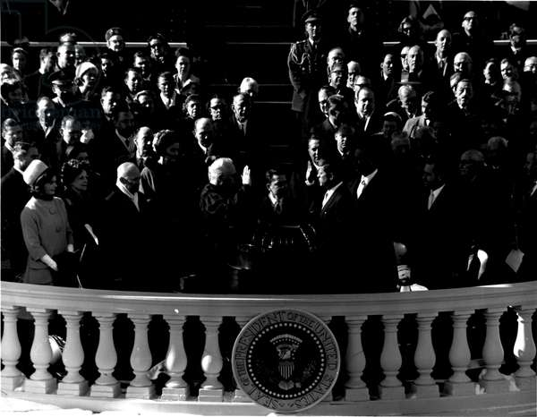 Jan 20, 1961; Washington, DC, USA; John F. Kennedy (1917-1963) is sworn in as President of the United States at the inaugural ceremony in front of the Capitol Building