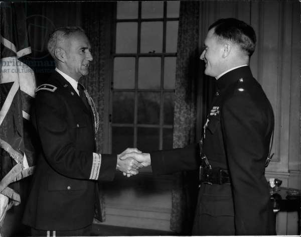 Tue 03, 1954 - American Decoration For British Colonel: Colonel. A.M. Man, DSO, OBE, HQ North-Umbrian District, Catterick Camp, Yorks, Receives The Legion Of Merit In The Degree Of Legionnaire From The U.S. Army Attaché General R.E.S. Williamson (Left) At To-Day; s, Mar 19, American Investiture At London's Winfield House. Colonel Man Was Decorated For Distinguished Service When Leading The 1st Battalion, Middlesex Regiment, In The British Commonwealth Division During The Fighting In Korea. In One Action Personally Led His Men Across A Footbridge Over The Nakton River Under Heavy Artillery Fire From The Enemy
