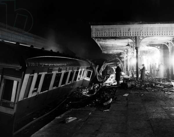 Jan. 01, 1955 - Fifteen dead in train Crash wreckage showing station platform, Fifteen people lost their lives and more than forty were injured when the 12-15 train from york to Bristol jumped the points at Sutton Goldfield station, Mr. Birmingham, last evening