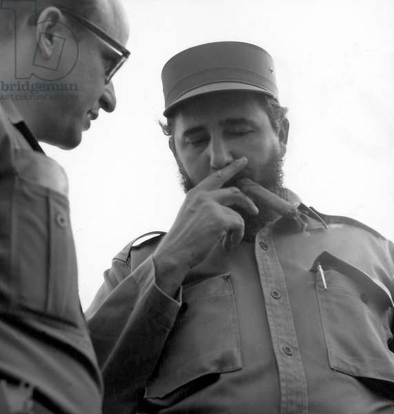 Portrait of Cuban head of state Fidel Castro smoking cigar, 1959 - 1961