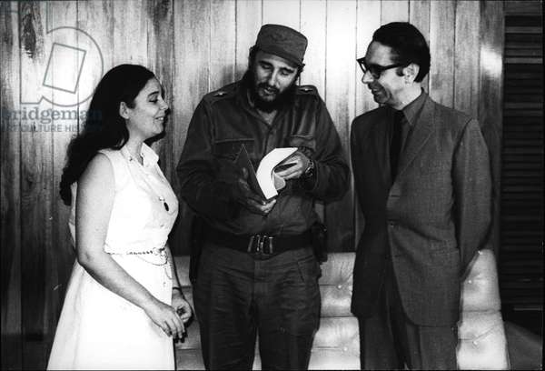 Jun 06, 1971 - Major Fidel Castro leaves With Senator Altamirano- Secretary General of The chilean Socialist Party and with Beatriz Allende, daughter of the Chilean