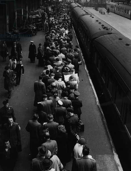 "Passengers waiting to board the ""Flying Scotsman"" train from London to Edinburgh at the time of transport strikes in May 1956"