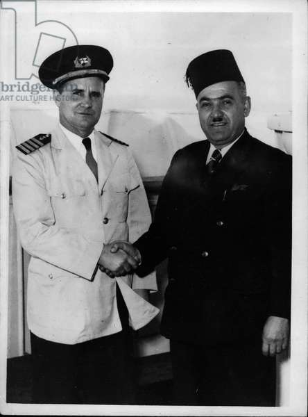 "Tue. 09, 1953 - Two Heroes of the Sea Left Carlsen of the"" Enterprise"" - Baltaji of the"" Chaepol Ion"": Two heroes of the sea met at Lebanese port recently. They were Captain Carlsen of the"" Flying Enterprise"" fame - and Rad wan Baltaji the port pilot who made three trips to the sinking liner"" Champollion"" in heavy seas when she ran aground off the Lebanese coast last December. He rescued about 50 people on each of his trips in spite of seas which were getting heavier each time. After that he got a smaller boat - which was easier to manage and made three trips to rescue about another 40 people. On the third trip the tiny boat - carrying thirteen survivors capsized twelve were rescued and one a little boy - died"