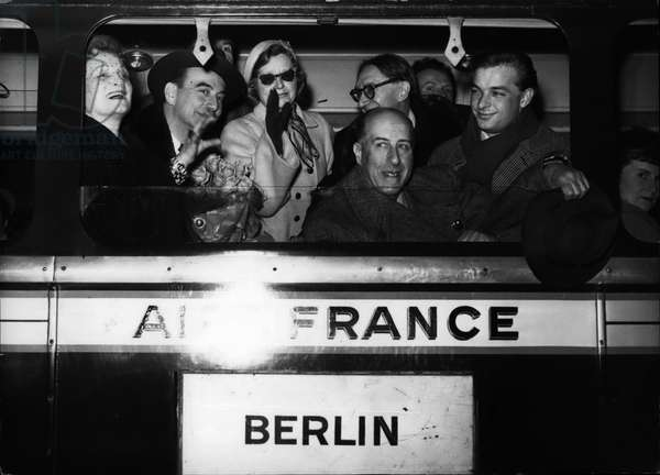 Apr. 04, 1954 - Off to Moscow: Actors of the Comedie Francaise who are to play in Moscow photographed in an air France Motor Coach leaving for Orly airfield. They are from L to R (First row) Germaine Rouer, Maurice Escande, Marie Sabouret, Raoul Henri and Roussillon. Part of the famous company are already in Moscow waiting for the remainder of the troop to join them