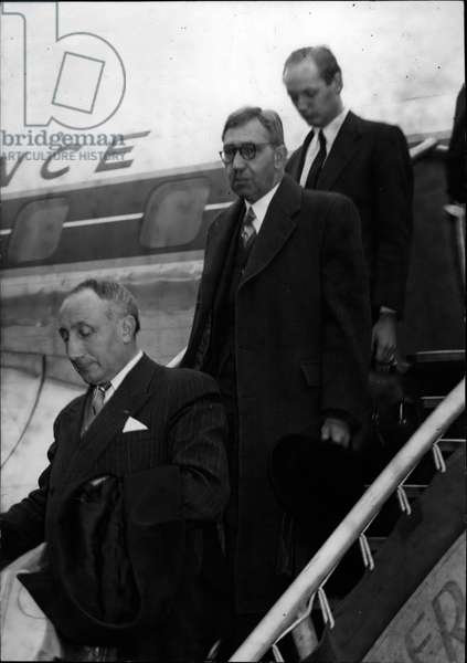 "Oct. 10, 1953 - LOD-MONTAGU OF BEAULieu ARRIVES IN PARIS LORD MONTAGU OF BEAULieu (FIRST FROM TOP) AGAINST -WHICH A WANT WAS ISSUED IN ENGLAND (FOR"" A GRAV PHOTOGRAPHED AS HE ALALAMED FROM AN AIR FRANCE PLANE WHICH Brought HIM FROM NEW YORK TO ORLY THIS MORNING° Lord Montagu Refused to be interviewed."