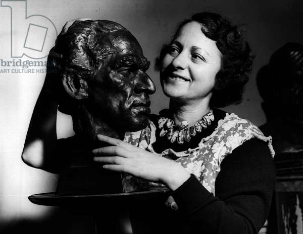 """Jan. 01, 1955 - Actress Sculptor Prepares For Her Exhibition Of"""" Personalities At Prime Minister's Conference"""" Miss Fredda Brilliant the actress sculptor wife of Herbert Marshall was to be seen at her St. John's Wood Studio this morning preparing for the exhibition of her work which is to be opened at the A.I.A. Galleries by Krishna Menon next week. The exhibition will include busts of some of the important personalities at the Prime at the Prime Ministers Conference"""