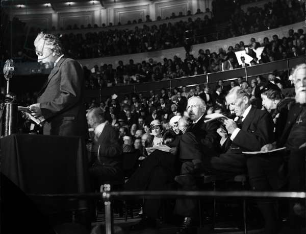 "Albert Einstein Speaking during his"" Science and Civilization"" lecture at the Royal Albert hall in 1933. Seated from left to right behind him are Lord Rutherford, and Sir Austen Chamberlain. (exact date unknown)"